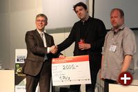 Univention-Absolventenpreis 2012: Martin Schobert mit Peter Ganten (Univention) und Jörg Thoma (golem)